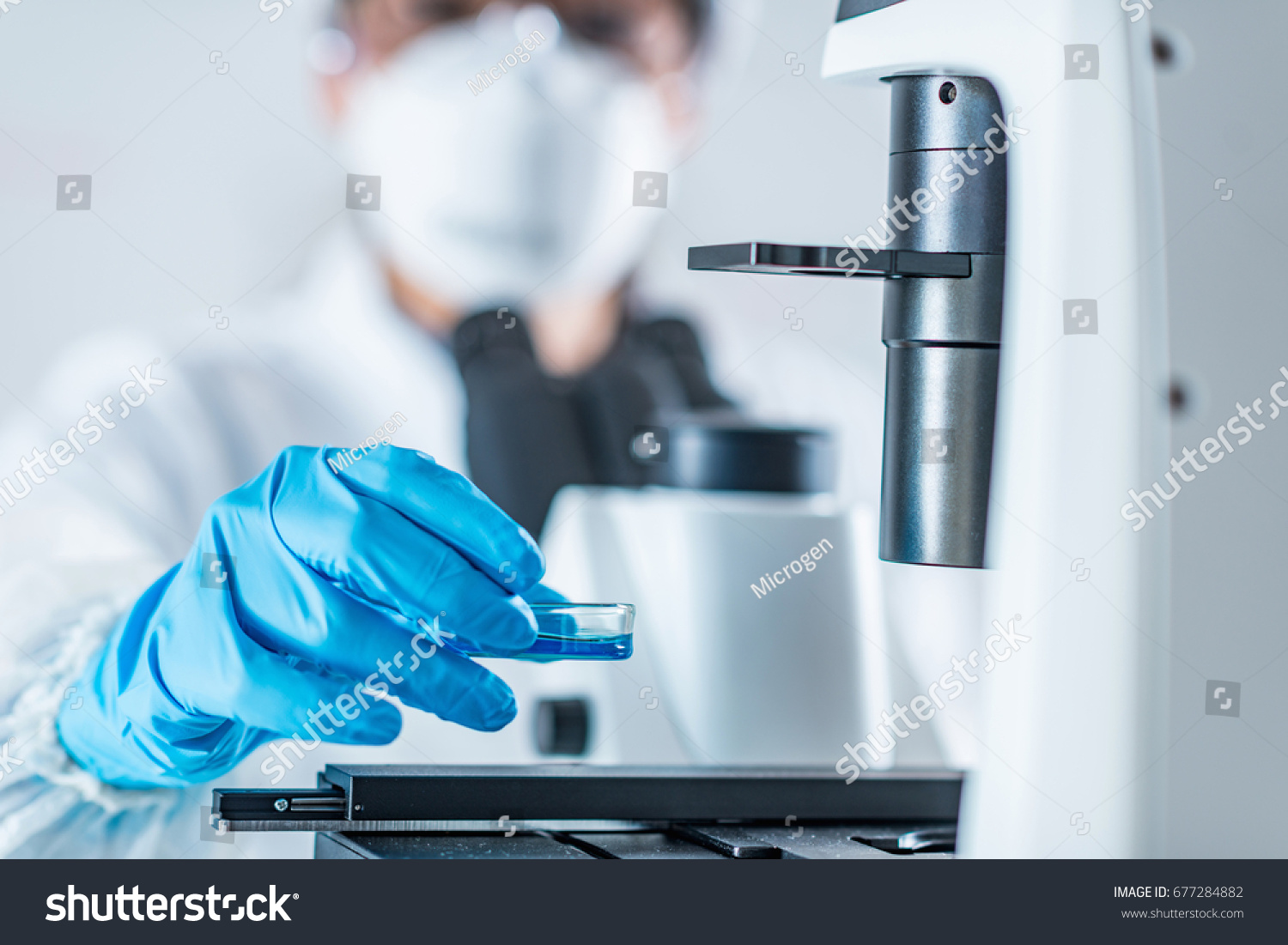 stock-photo-biotech-lab-research-placing-petri-dish-with-cell