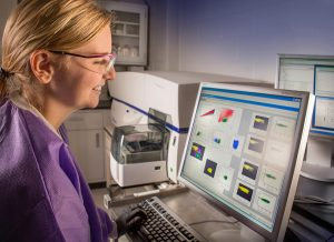 research scientist reviewing flow cytometry data